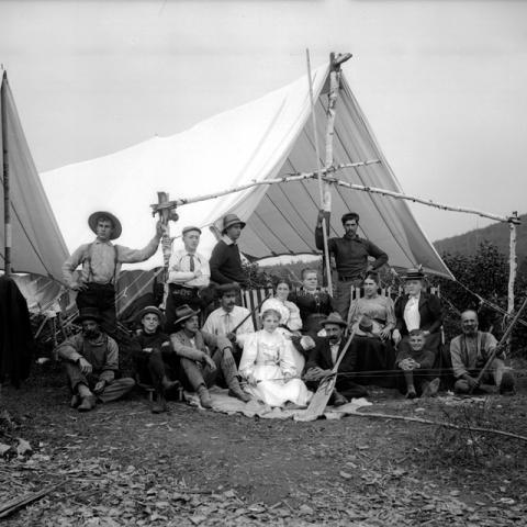 A family posing in front of a hunting tent