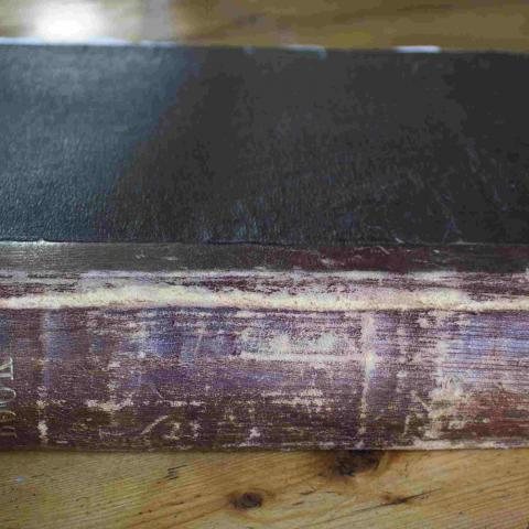 Photograph of an old book binding.