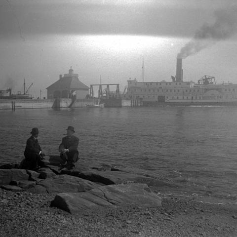 A cruise steamer at the end of a wharf.