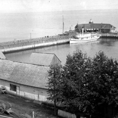 A wharf extending into the river.